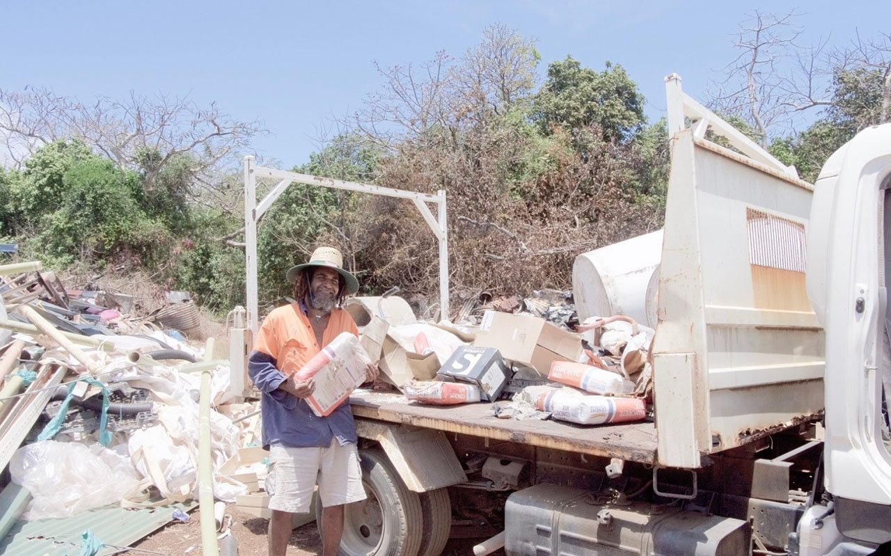 Gelam Salee taking rubbish to the dump at Mer